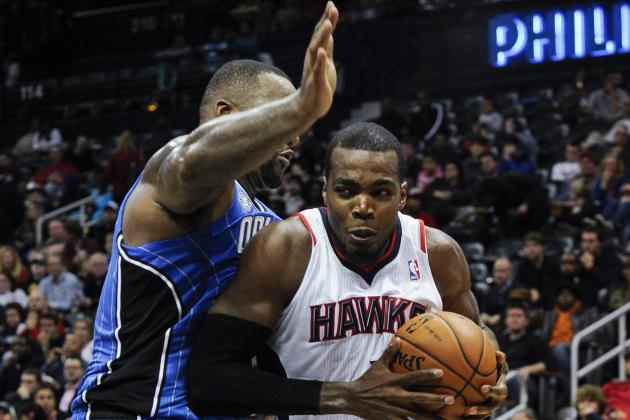 Hawks Hang on to Beat Magic 112-109
