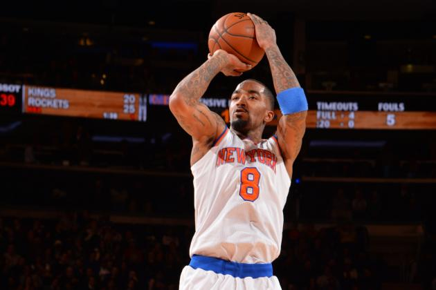 J.R. Smith Plays Air Guitar During Halftime Act