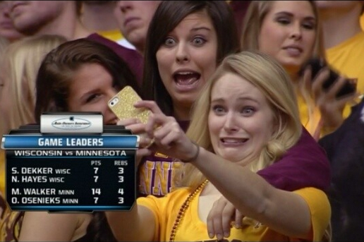 Minnesota Basketball Fans Captured on TV Taking Multiple Selfies