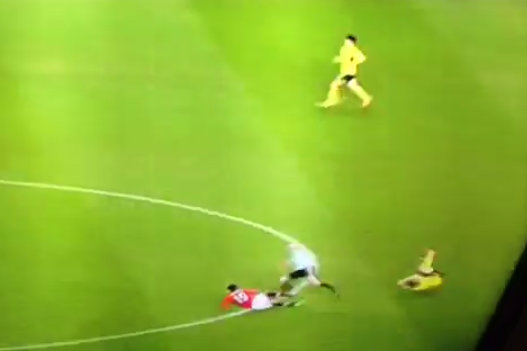 Watch: Referee Takes out Two Players in One Fell Swoop