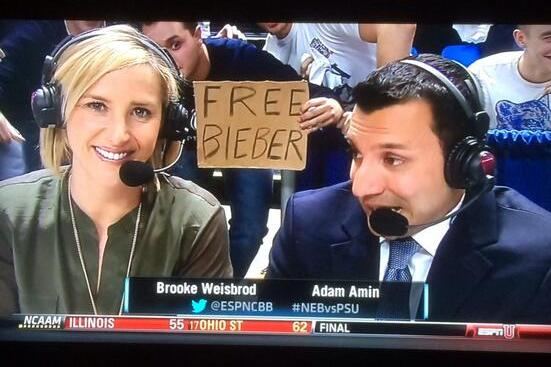 ESPN Announcers Photobombed by Absurd 'Free Bieber' Fan Sign