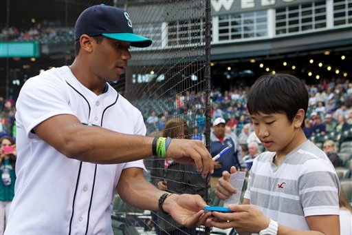 Seattle Seahawks' Russell Wilson Appears on Texas Rangers Baseball Card