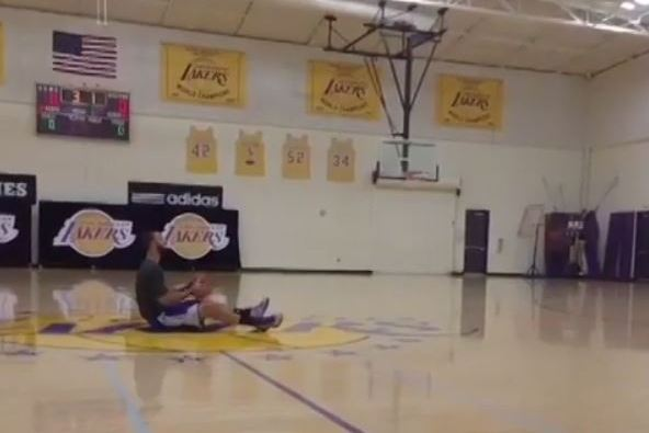 Lakers' Kendall Marshall Swishes Half-Court Shot While Sitting Down