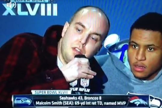 Fan Crashes Malcolm Smith's Super Bowl Press Conference with 9/11 Message