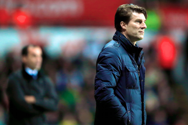 Swansea City and Manager Michael Laudrup Part Ways