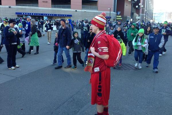 Fan Decked out in 49ers Gear Shows Up at Seahawks Championship Parade