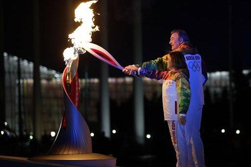 Vladislav Tretiak and Irina Rodnina Light 2014 Olympic Cauldron in Sochi