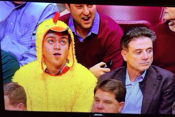 Rick Pitino Sits Next to a Kid in a Chicken Suit at Minnesota Game