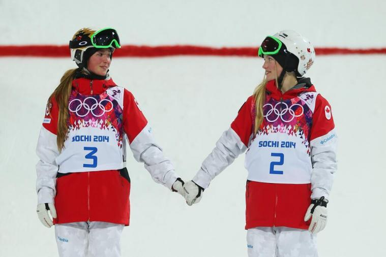 Olympic Sisters Justine and Chloe Dufour-Lapointe Hold Hands on Medal Podium