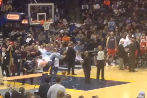 Memphis Grizzlies Mascot Sends Wizards Fan Through Table with Powerbomb