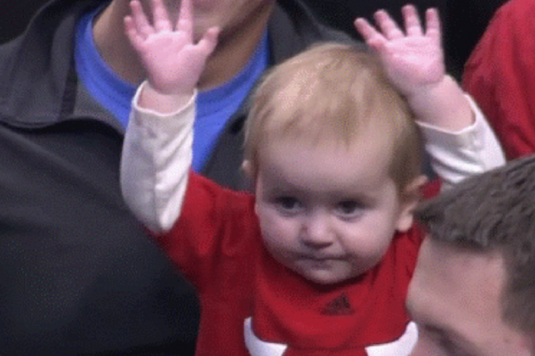 Baby Dances with Hands in the Air at Chicago Bulls Game