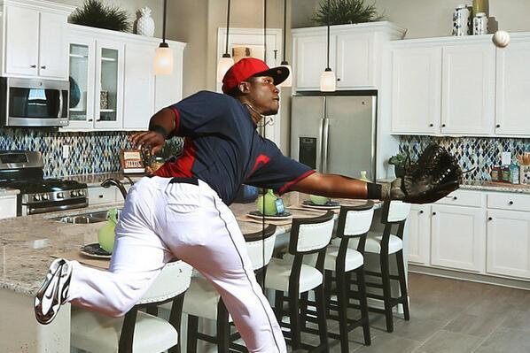 Indians' Carlos Moncrief Becomes Part of Illusion Thanks to Ad on Outfield Wall