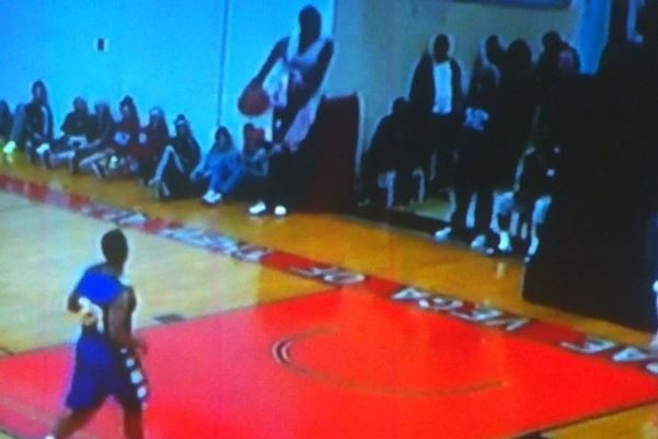 College Basketball Player Throws Down Between-the-Legs Dunk During Game
