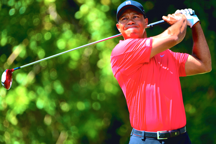 What Does Tiger Woods' Back Injury Mean for His 2014 Season?
