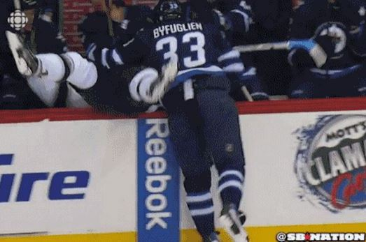Jets' Dustin Byfuglien Sends Kings' Jake Muzzin into Bench with Huge Check