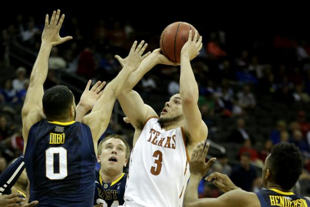 Texas Romps Past West Virginia 66-49 in Big 12s