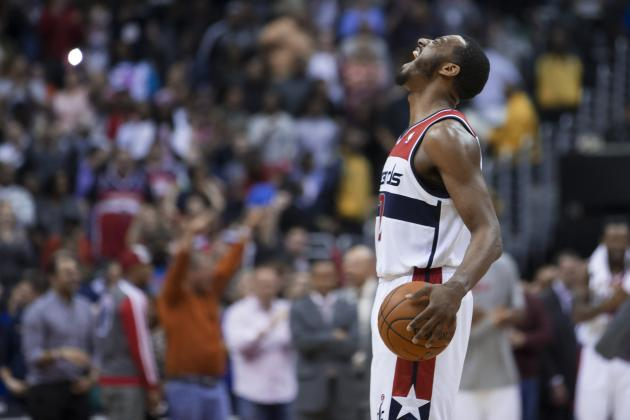 John Wall Leapfrogs Wizards Bench and Crashes into Assistant Coaches