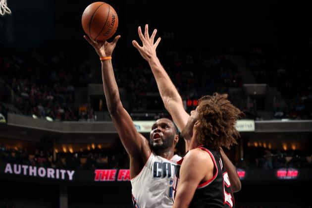 Al Jefferson Leads Bobcats' Rout of Portland with Michael Jordan Next to Bench