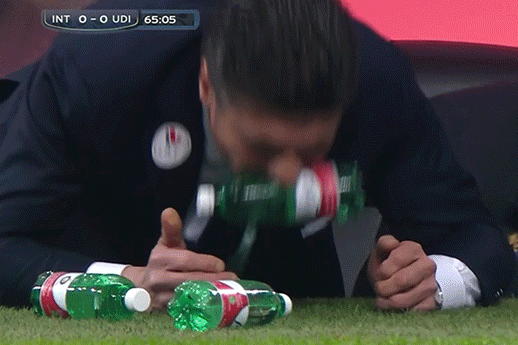 GIF: Walter Mazzarri Bites Water Bottles in Frustration on Inter Milan Touchline