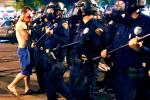 Riot Police, Arizona Students Face Off...