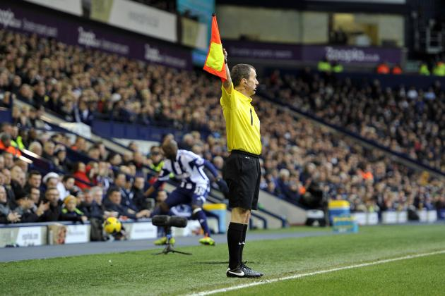 Everton Fan Shakes White Stick at Linesman in Match vs. Fulham