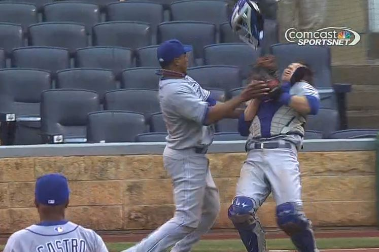 Cubs Pitcher Pedro Strop Knocks Down Catcher John Baker While Catching Ball
