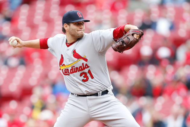 Cards Survive Rain, Replay to Beat Reds 7-6