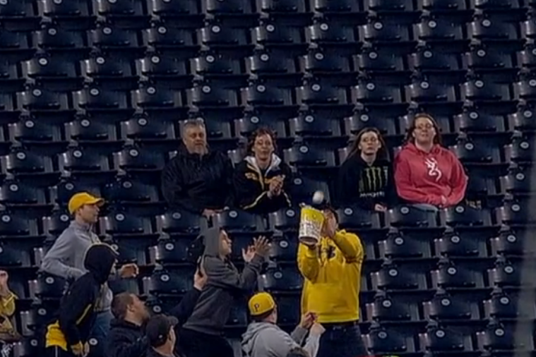 Pirates Fan Catches Foul Ball Using Tub of Popcorn
