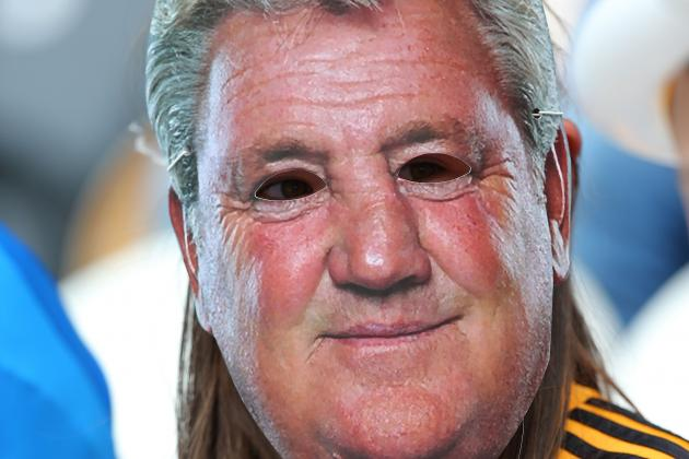Fans Wear Steve Bruce Mask at Hull City vs. Swansea Premier League Match