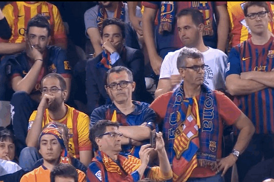 GIF: Telling Reactions of Atletico and Barcelona Fans