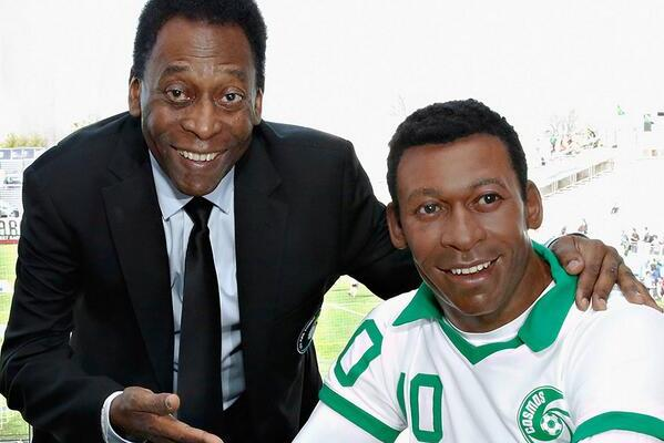 Pele Poses with Waxwork of New York Cosmos Pele That Doesn't Look Much Like Pele