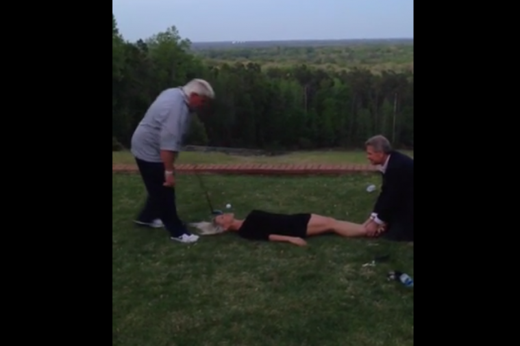 John Daly Shows off Good Swing While Hitting Golf Ball Teed Up in Woman's Mouth