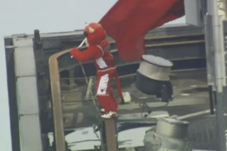 Benny the Bull Waves Chicago Bulls Flag on Edge of Willis Tower