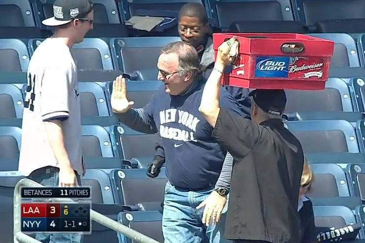 Yankees Fan Falls over While Whiffing on Foul Ball, Misses High-Five Attempt