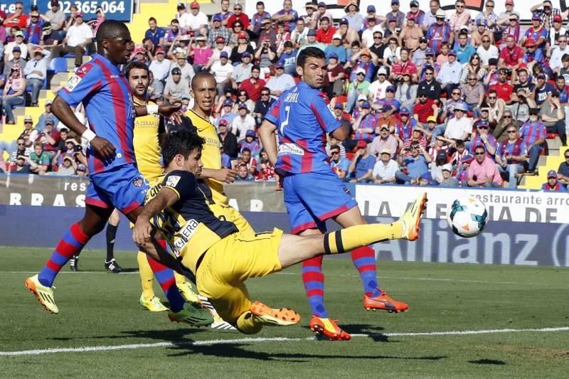 Atletico De Madridsgo Costa Front Shoots The Ball As Levantes David Barral