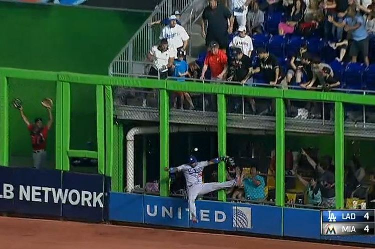 Yasiel Puig Violently Collides with Outfield Wall on Game-Winning Hit