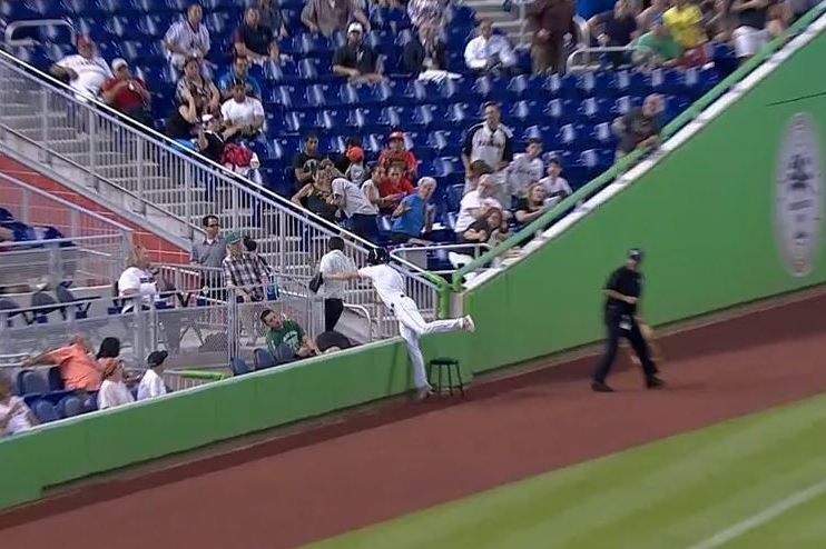 Marlins Ballboy Flashes Leather as He Goes over Wall for Foul Ball