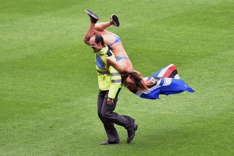 Pitch Invader Wearing Bikini Dragged off