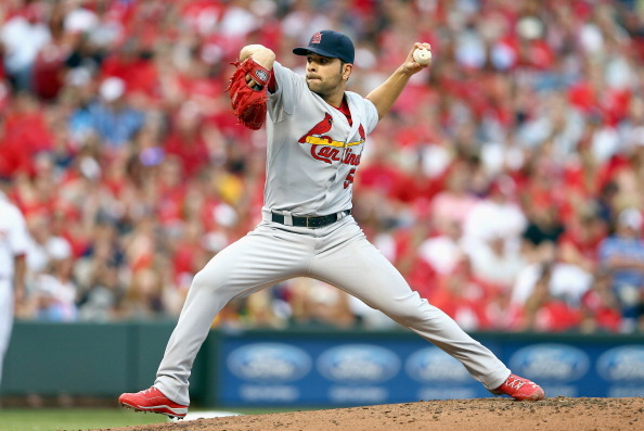 Garcia Gets a Win, Cardinals Beat Reds 6-3