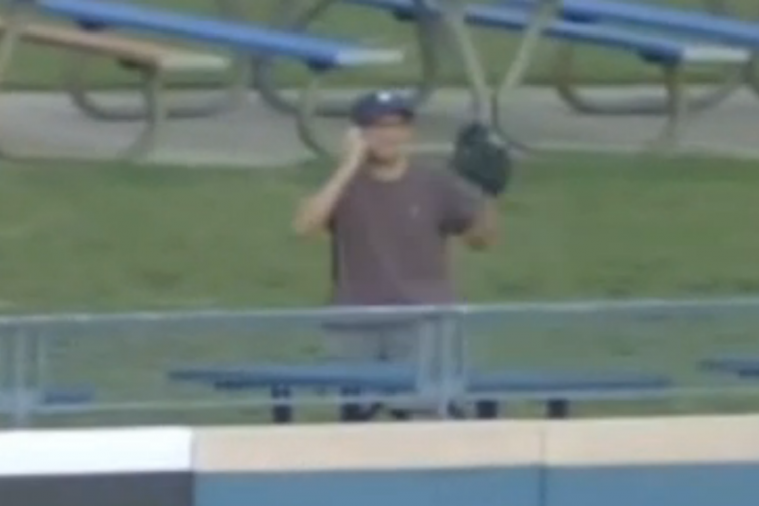 Fan on His Phone Catches Home Run Ball at a Triple-a Baseball Game