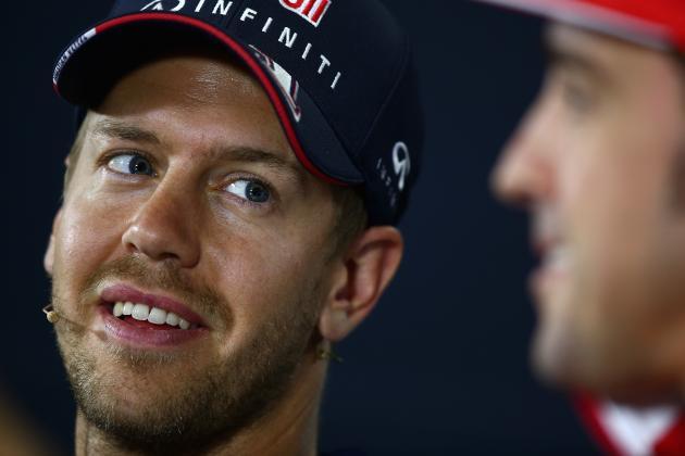 Assessing Rumours Linking Sebastian Vettel Joining Ferrari from Red Bull