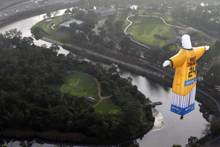 Christ the Redeemer Flies as a Socceroo and a Hot Air Balloon