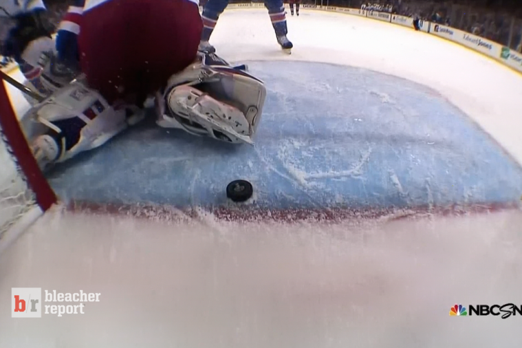 Puck Stops on Ice Inches Short of the Rangers Goal in Game 4