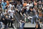 Woah: Dad Catches HR While Holding Baby