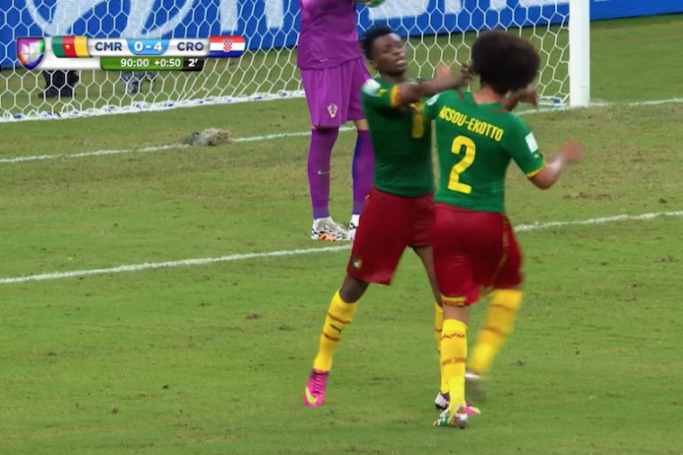 Cameroon Players Benoit Assou-Ekotto and Benjamin Moukandjo Go After Each Other