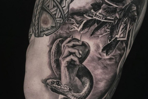 Colin Kaepernick Gets Tattoo Showing the Corruptive Nature of Money