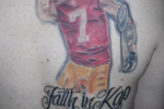 Fan Gets Large Back Tattoo of Kap Kissing His Bicep