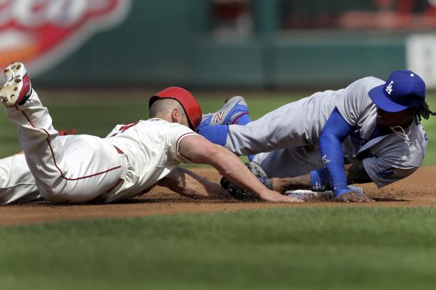 Holliday Exits vs. Dodgers After Collision with Ramirez