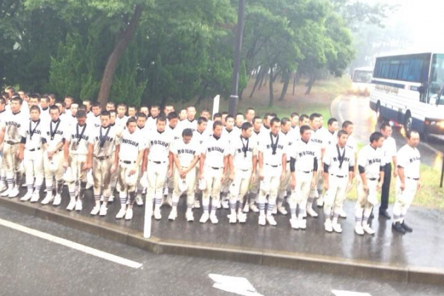 Japanese Baseball Team Stands in Downpour for an Hour to Thank Supporters