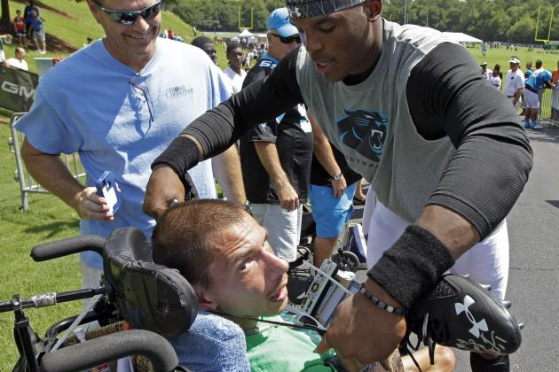 Cam Newton Took off His Cleats, Autographed Them for a Fan in a Wheelchair